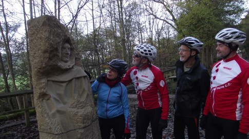 Cyclists viewing Pillars Past; the Pateley Bridge sculpture which is part of the Travelling Histories, Passing Places project for the Way of the Roses route. See also Bentham Loop.